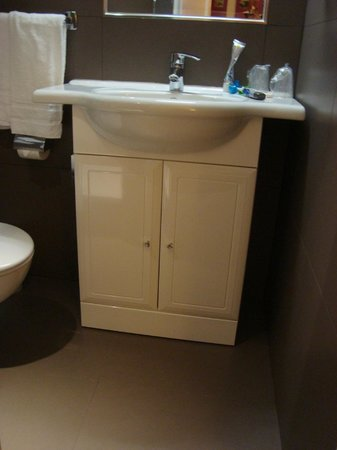 New Orient Hotel: Bathroom sink (enough space for toiletries; cabinet is clean)