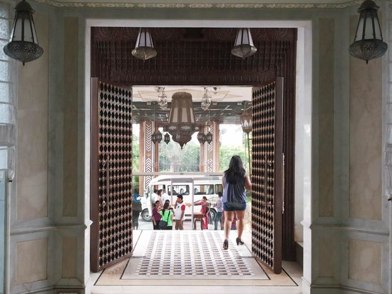 Orient Taj: Impressive brass studded wooden entrance door.