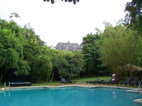 Sigiriya Village Hotel: view of Lion's Rock from pool area