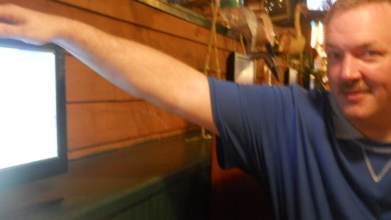 Thorny's: Husband playing with the Booth TV!
