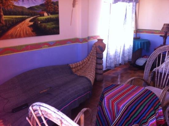 Hostel Leyenda: room1 with table and chairs, reed couch, private terrace