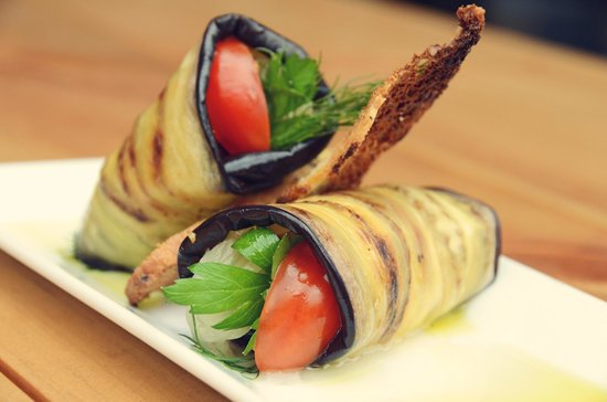 ... Roasted eggplant wrap with confit onion with dill and cherry tomatoes