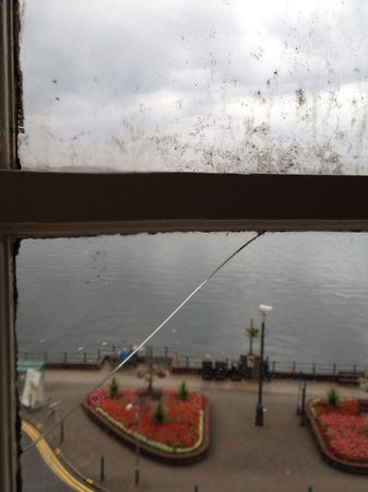 The Palace Hotel: View with smashed fly and broken window