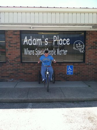 Adam's Place: Adam in front of the building