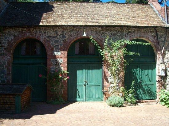 Bourn House: Three doors for the garage.