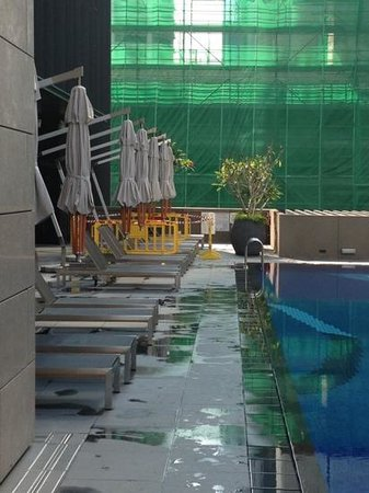 pool area.  note yellow barriers in background where they have cordoned off areas still in const