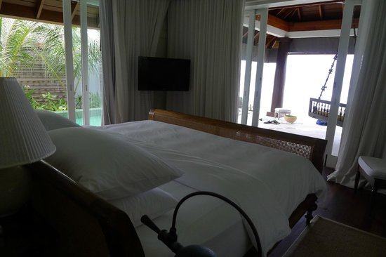 Naladhu Resort Maldives: view of pool and beach from bedroom