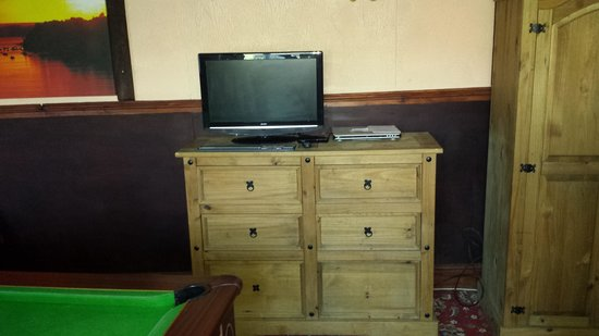 Jasmine House: tv and dresser in games room
