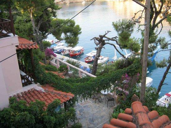 Nina Pansion: Stone walkway from balcony at Nina's