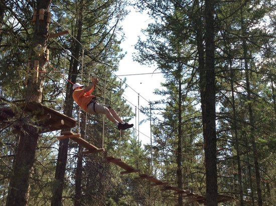 WildPlay Element Parks Kelowna : Holding onto clip, head and hands close to zipline, small harness