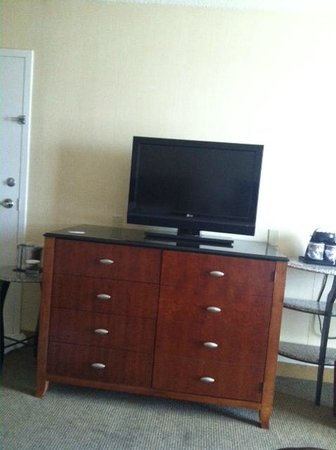 Doubletree Hotel Tallahassee: Dresser and tv, The right side is actually a door that contains a mini fridge