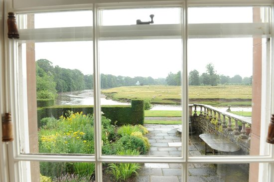 Warwick Hall: The view of the river and sheep from the dining room