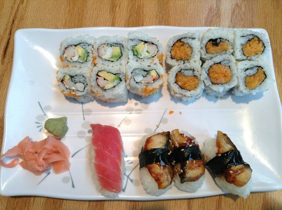 Toshi Sushi & Grill: two rolls, eel sushi, and salmon sushi