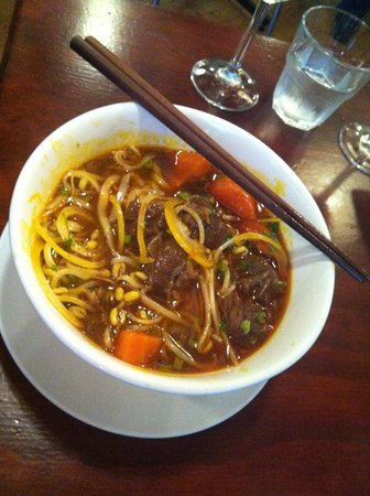 Nam: Slow cooked spiced lemongrass beef stew on noodles