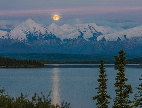 Full super moon reflected in Wonder Lake