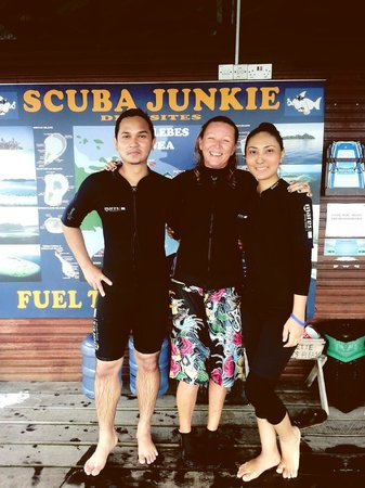 Scuba Junkie Mabul Beach Resort: Me with my wife & our buddy instructor