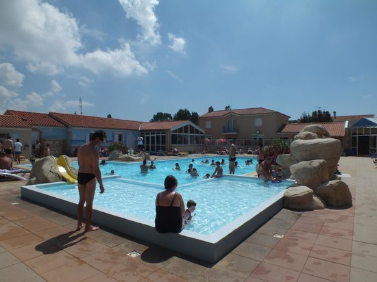 Camping Le Bois Joly : Pools. There is an indoor one and slides behind where I stand.