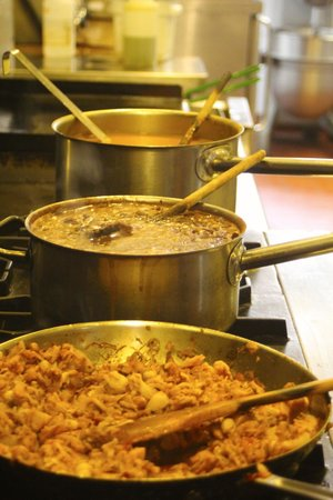 Adama Vegan Comfort Cuisine: A view from the kitchen with some stews cooking.