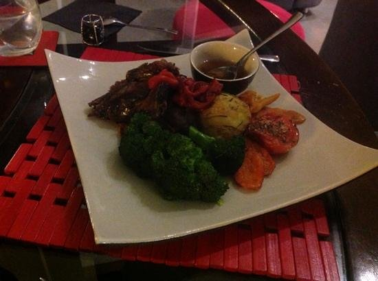 Eagles Nest Retreat: Main - Roast Lamb coated with home grown herbs & served with Seasonal Vegies and homemade mint s