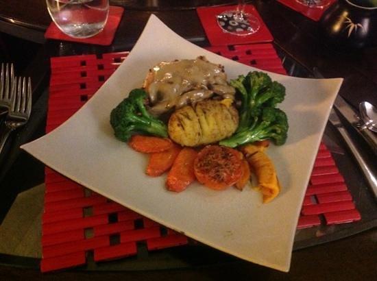 Eagles Nest Retreat: Chicken Breast stuffed with garlic & herbs, served with fresh vegies $ mushroom gravy