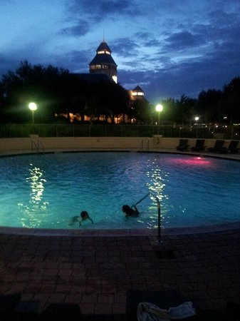 The Renaissance World Golf Village Resort: Night time swimming in front of the Golfer's Hall of Fame