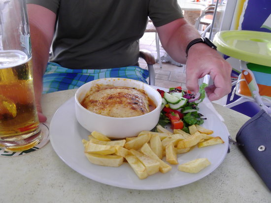 Oasis Pool Bar : Mousaka comes with chips and salad unlike most resteraunts