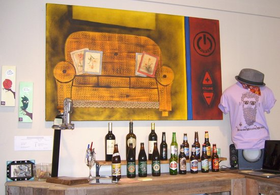 The White Buffalo: Art Over Bar Serving Beer and Wine
