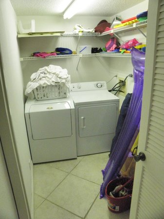 Ram Sea Condominiums: Washer and dryer area with beach items provided by owner
