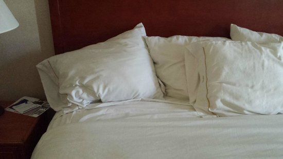Holiday Inn Express Lawrence : Not how we usally find our pillows on a made bed.