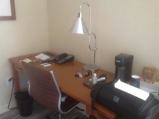 Four Points by Sheraton Bangor Airport: desk area with coffee maker.