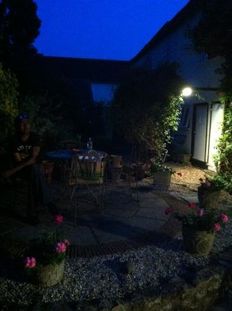 Ammonite Lodge Guest House: tranquil Mediterranean style courtyard at night, a lovely place to relax