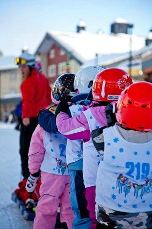 Big White Ski Resort: Sarah leading the kids to the gondola/magic carpet