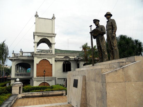 CAP Building: The Price Mansion, with a bronze figure of Gen MacArthur and Pres. Osmena