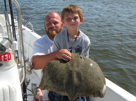 Black bass fun for boys picture of reel action fishing for Reel action fishing charters