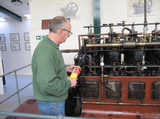 Anson Engine Museum: Geoff Challinor heats up the pre heaters, with a blow torch.