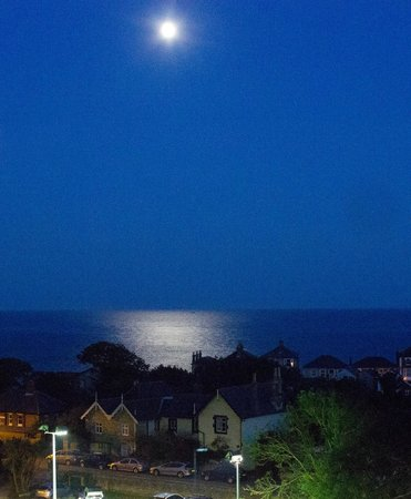Hillside Hotel: View over Ventnor to the sea on a full moon.