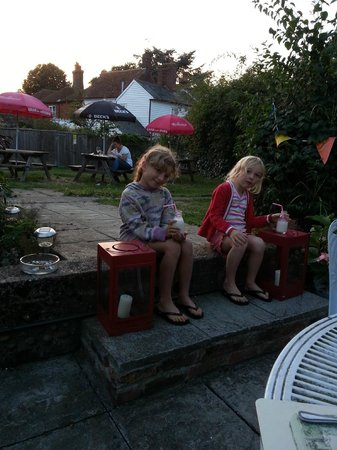 The Bell at Iden: Back garden with funky milk bottles!
