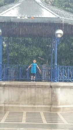 my son playing in the rain at plaza pombo