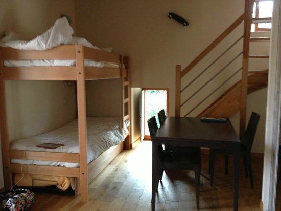 Hostellerie du Perigord Vert : downstairs area with dining table, beds, bathroom and toilet