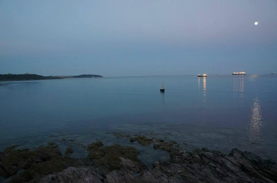 Hooked on the Rocks: Early evening view of the sea from our table