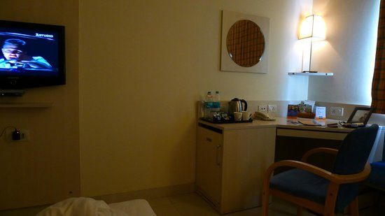Aditya Hometel: Room inside with the minibar, tea kettle and TV