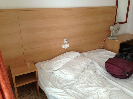 "Hostal Montana: Twin beds pushed together to make a double... room's ""fan"" to the right."