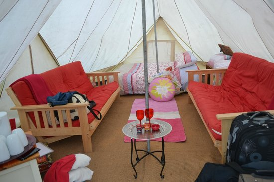 Battlebridge Caravan & Camping Park : Inside one of the Teepee tents after we piled luggage for 5 people into it