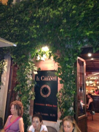 Vineria Il Chianti : Restaurant sign behind the outdoor seating and door leading to inside