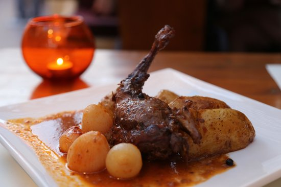 Karma: Marinated Rabbit in red wine and cooked with mini onions, potatoes  and garlic