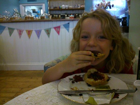 Enjoying a fruit scone at Tiffins