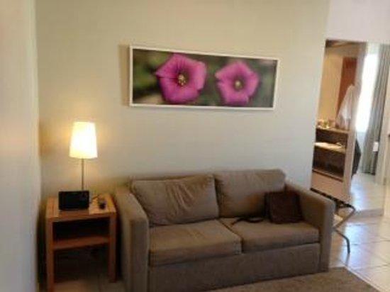 Impar Suites Cidade Nova: sofa confortable