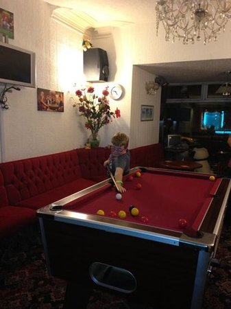 Hotel Jeanne: My son Robert enjoying a game of pool in the hotel lounge.