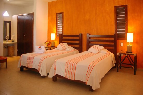 Twin bedroom Villas El Encanto Cozumel