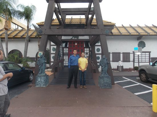 Arigato Japanese Steak House: My son and I out in front of Arigato.